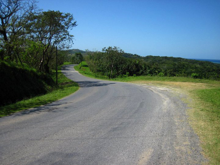 Just a small stretch of an absolutely gorgeous road on Roatan Island. Save for a military checkpoint, traffic was almost non-existant on the eastern side of the island.